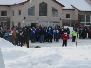Teams gather in front of CBNA'S Smith Hall for Opening Ceremonies.