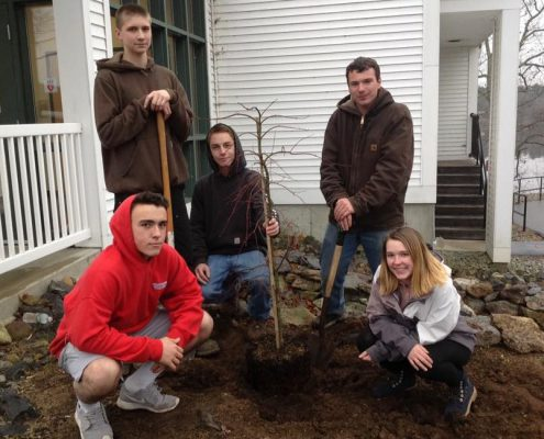CBNA Landscaping students (left to right) Matt Messenger, Colin Golihur, John Renner, Devin Sullivan, and Sarah Jensen plant tree donated by Patuckaway Nursery.