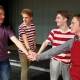 From left – Ferdinand (Cooper Leduke), Berowne (Brian Downer), Longaville (Aiden Schutte), and Dumain (Connor Nowak) swear an oath for no fun, food or females in CBNA Theatre's production of Love's Labor's Lost