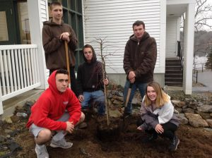 CBNA Landscaping students (left to right) Matt Messenger, Colin Golihur, John Renner, Devin Sullivan, and Sarah Jensen plant tree donated by Patuckaway Nursery.