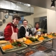 CBNA FBLA members serving at New Horizons Soup Kitchen - left to right: Riley Smith, Hailie Holland, and advisor Dr. JoAnn Zylak